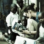 Laura Corcoran reads to some children books that were donated by Bishop Flaget School in Chillicothe, Ohio