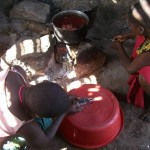 Children Making Water Filters for Tank
