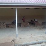 Students at the Vocational School complete their practicum of brick laying.