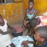 Children prepare beans for supper