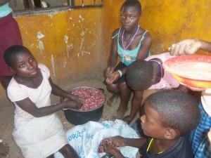 children preparing beans